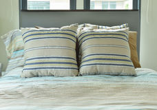 Bedroom with striped bedding in pastel tone Royalty Free Stock Photo