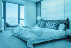 Bedroom Suite. Master bedroom with beautiful bed and linens and big window Royalty Free Stock Photography
