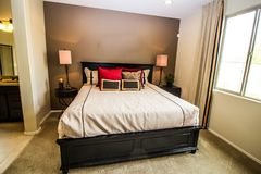 Bedroom Suite With Nightstand, End Table And Lamps stock photo