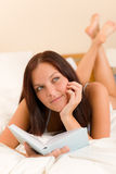 Bedroom thoughtful woman read book in bed Royalty Free Stock Photo