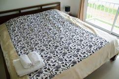 Bedroom. Towel on bed in bedroom Stock Photo