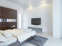 Bedroom with TV and a media console. Stock Image