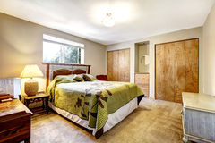 Bedroom with two closets. Bedroom with wooden furniture set and two closets stock photos