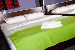 Bedroom with two towels on the bed Royalty Free Stock Photo