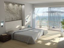 A bedroom with a view. A summer house bedroom with a sea view Stock Photo