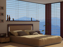 A bedroom with a view. A contemporary bedroom with a view to a nearby mountain Stock Photos