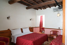 Bedroom. View of a bedroom in a rustic farmhouse in Rome Stock Images