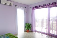 Bedroom violet windows Royalty Free Stock Images