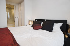 Bedroom with walk in wardrobe and suite bathroom Stock Photos