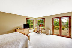 Bedroom with walkout basement deck Royalty Free Stock Image