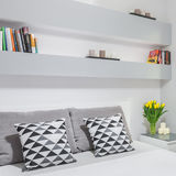 Bedroom with wall bookshelf Royalty Free Stock Photography