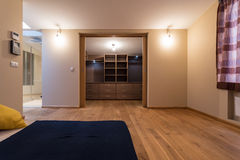 Bedroom with wardrobe in the apartment. Large bedroom with wardrobe in the apartment Royalty Free Stock Photo