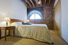 Bedroom in a warehouse conversion. With exposed brick work royalty free stock images