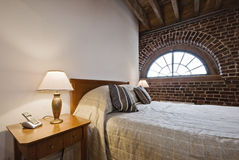 Bedroom in a warehouse conversion Royalty Free Stock Image