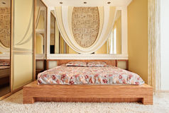 Bedroom in warm tones. With mirrors royalty free stock images