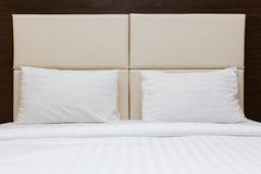 Bedroom with white pillow and leather headboard Royalty Free Stock Image