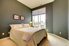 Bedroom wiht grey green walls and white bedding. Stock Images