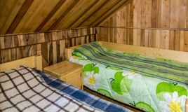 Bedroom in a Wooden Chalet. Bedroom with two beds in a wooden chalet Royalty Free Stock Photography