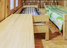 Bedroom in a Wooden Chalet. Bedroom with two beds in a wooden chalet Royalty Free Stock Images