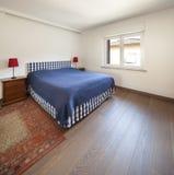 Bedroom with wooden floor Stock Photos