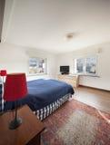 Bedroom with wooden floor Royalty Free Stock Photo