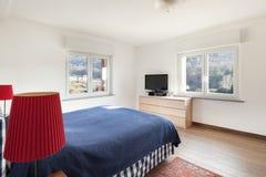 Bedroom with wooden floor Stock Photo
