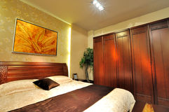 Bedroom with wooden furniture Stock Image