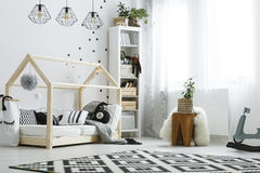 Bedroom with wooden house bed Royalty Free Stock Images