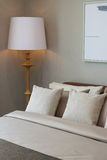 Bedroom with wooden lamp Stock Photos