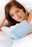 Bedroom - young woman read book Stock Image