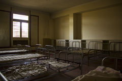 Beds in an abandoned room Royalty Free Stock Photography