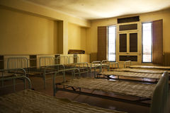 Beds in an abandoned room Royalty Free Stock Photo