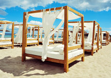 Beds in a beach club in Ibiza, Spain. View of some beds in a beach club in a white sand beach in Ibiza, Spain royalty free stock photo