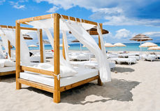 Beds in a beach club in Ibiza, Spain. View of some beds in a beach club in a white sand beach in Ibiza, Spain royalty free stock image