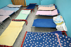 Beds and cots in brightly colored dormitory of a nursery Stock Photo