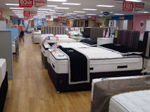 Beds on display for sale in a store. Stock Images