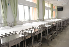 Beds in hospital. Corridor in hospital with beds Royalty Free Stock Images