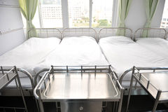 Beds in hospital. Corridor in hospital with beds Stock Image