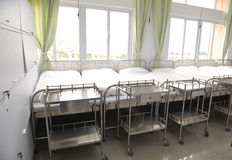 Beds in hospital. Corridor in hospital with beds Stock Images