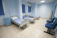 Beds in a hospital ward Stock Photo