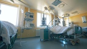 Modern ward at a clinic. Hospital room full of medical equipment. stock video footage