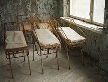 Beds for newborn babies in deserted hospital in Pripyat, Chernobyl, Ukraine. royalty free stock photography