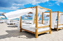 Beds and sunloungers in a beach club in Ibiza, Spain. Detail of some beds and sunloungers in a beach club in a white sand beach in Ibiza, Spain Stock Photography