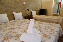 Beds with swan of towel from a hotel Royalty Free Stock Image