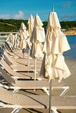 Beds and umbrellas on tropical beach in st johns, antigua. Summer vacation on caribbean. Recreation, leisure, sunbathing, bathing concept stock photography