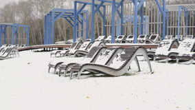 Beds in the winter in park. Chaise winter stock video