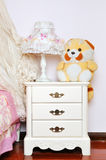 Bedside cabinet and lamp Stock Photos