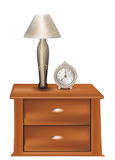 Bedside with a lamp and an old clock royalty free stock photos