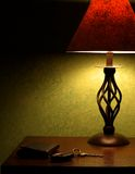 Bedside Nightstand. This is a picture of a bedside nightstand against a faux painted wall Stock Images
