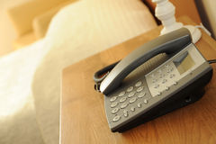 Bedside phone. Photograph of a telephone on a bedside table Royalty Free Stock Photo
